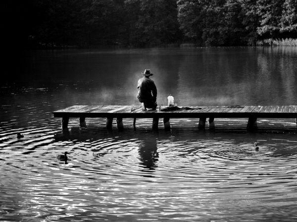 Hunter sitting at a dock