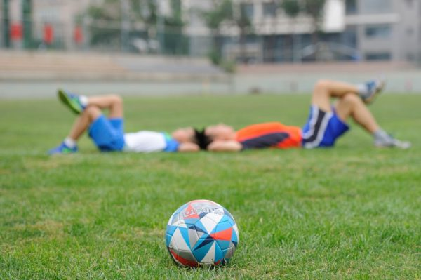 Soccer players enjoying a break