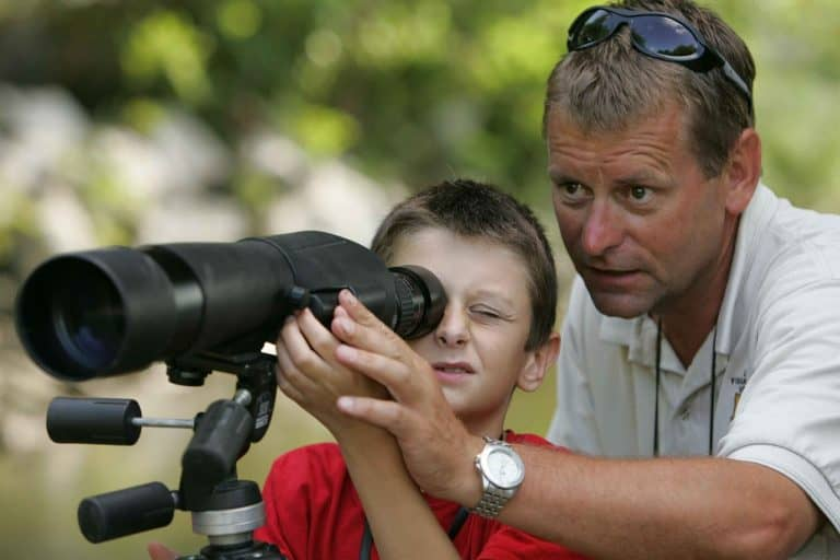 Man and child using a spotting scope